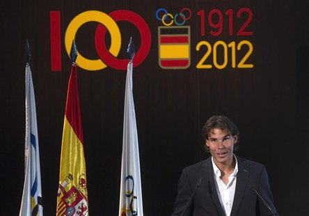 Tennis player Rafael Nadal, the official Spanish flag barrier at the London Olympics, speaks during a handover ceremony in Madrid in this fi