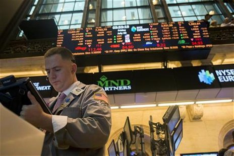 A trader works on the floor of the New York Stock Exchange in New York July 20, 2012. REUTERS/Keith Bedford