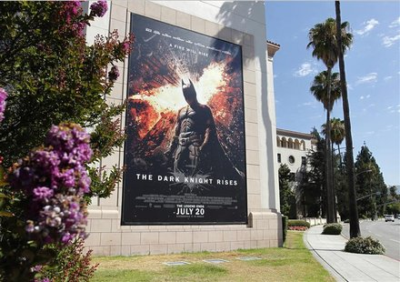 "A poster for the Warner Bros. film ""The Dark Knight Rises"" is displayed at Warner Bros. studios in Burbank, California, July 20, 2012. REUTE"