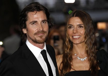 "British actor Christian Bale and his wife Sibi pose for photographers as they arrive at the European Premiere of ""The Dark Knight Rises"" in"