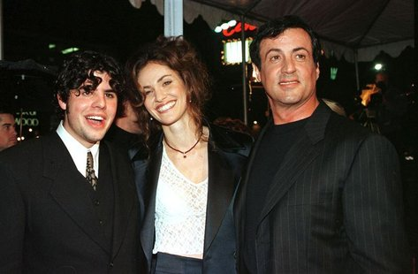 "Sage Stallone, (L) appears at the premier for ""Daylight"" with Amy Brenneman and his father Sylvester Stallone (R) in Los Angeles in this Dec"