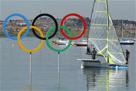 Peter Burling and Blair Tuke of New Zealand, competing in the 49er class sailing competition, trains near the Olympic Rings ahead of the sta