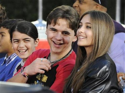 Michael Jackson's children (L-R) Blanket, Prince and Paris share a laugh at a ceremony where the singer is immortalized with hand and foot i