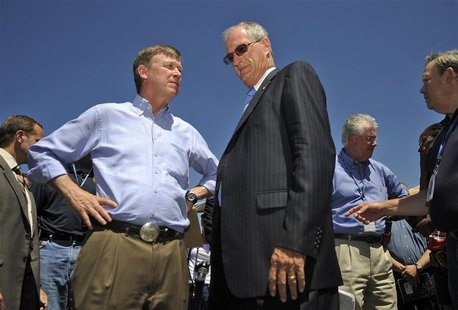 Colorado Governor John Hickenlooper (L) and Aurora Mayor Steve Hogan attend a news conference following the Century 16 Theater shootings in