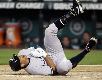 New York Yankees' Alex Rodriguez falls to the ground after being hit by a pitch from Seattle Mariners starting pitcher Felix Hernandez durin