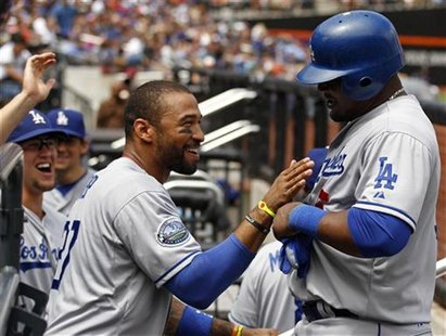Los Angeles Dodgers Matt Kemp congratulates Juan Uribe after scoring on an RBI single by Dodgers Luis Cruz against the New York Mets during