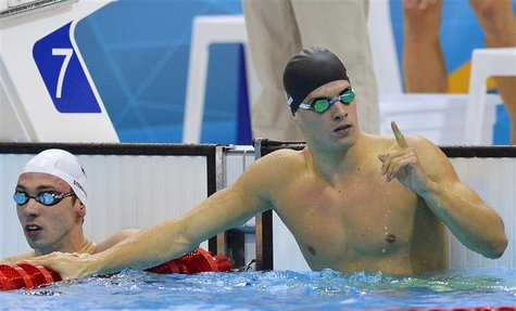 Hungary's Daniel Gyurta reacts after he took first place in heat 4 during the men's 100m breaststroke heats at the London 2012 Olympic Games