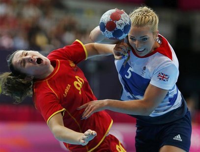 Montenegro's Milena Knezevic (L) fights for the ball with Britain's Nina Heglund during their women's handball Preliminaries Group A match a