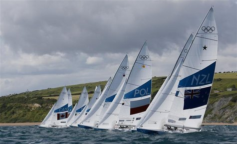 A fleet of Star class keelboats starts during a practice race at the London 2012 Olympic Games in Weymouth and Portland, southern England, J