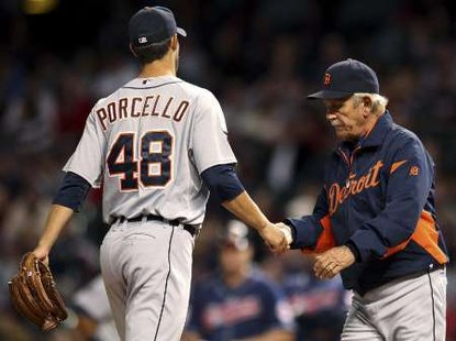 Detroit Tigers starting pitcher Rick Porcello, handing the ball to manager Jim Leyland.  Porcello gave up five earned runs in six innings pitched, as the Tigers lost to the Blue Jays on July 27, 2012, in Toronto (REUTERS)