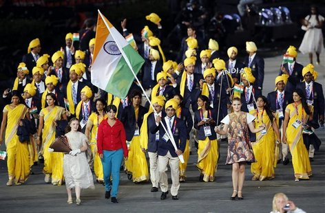 India's flag bearer Sushil Kumar holds the national flag as he leads the contingent in the athletes parade during the opening ceremony of th