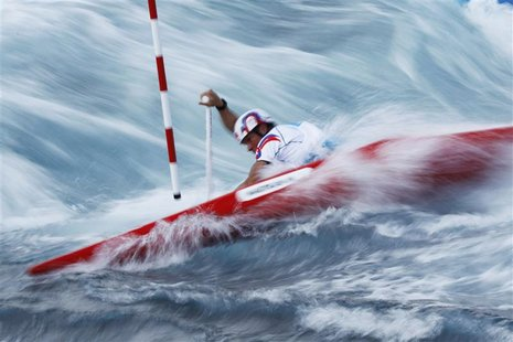 Slovakia's Michal Martikan competes in the men's canoe single (C1) heat at Lee Valley White Water Centre at the London 2012 Olympic Games Ju