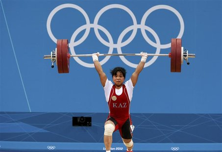 Kazakhstan's Zulfiya Chinshanlo lifts to set new clean and jerk World record and total Olympic record on the women's 53Kg Group A weightlift