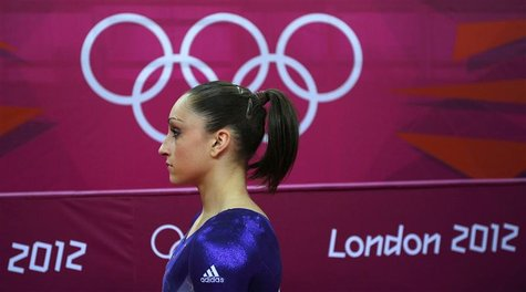 Jordyn Wieber of the U.S. waits after competing in the vault during the women's gymnastics qualification in the North Greenwich Arena during