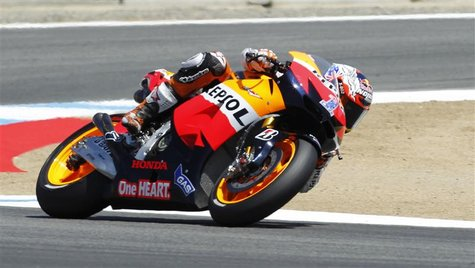 Casey Stoner of Australia accelerates during his second place qualifying finish at the U.S. Grand Prix Moto GP world championship motorcycle