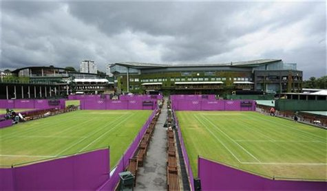 Outside courts are surrounded with Olympic hoarding at the All England Lawn Tennis Club (AELTC) as preparations are made for the London 2012