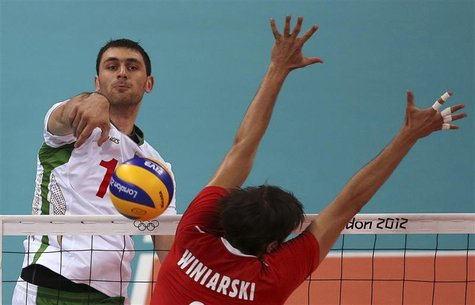 Bulgaria's Tsvetan Sokolov (L) spikes the ball against Poland's Michal Winiarski during their men's Group A volleyball match at the London 2