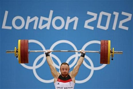 Great Britain's Gareth Evans competes on the men's 69Kg Group B weightlifting competition at the London 2012 Olympic Games July 31, 2012. RE