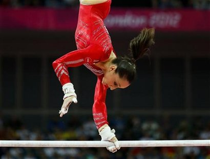 Jordyn Wieber of the U.S. performs on the asymmetric bars during the women's gymnastics team final in the North Greenwich Arena at the Londo