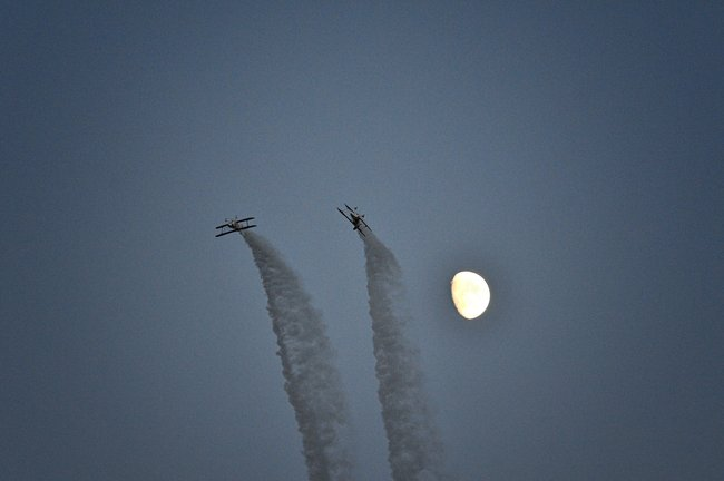 Moon made for a great backdrop to planes flying in the Night Show!