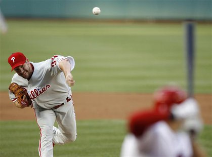 Philadelphia Phillies starting pitcher Cliff Lee pitches against the Washington Nationals in the first inning of their MLB baseball game in