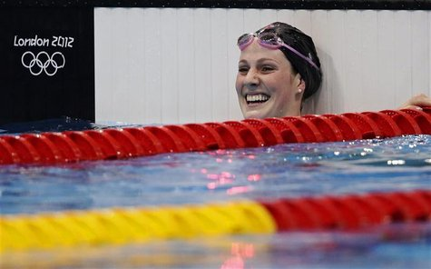 Missy Franklin of the U.S. celebrates after winning the women's 100m backstroke final at the London 2012 Olympic Games at the Aquatics Centr