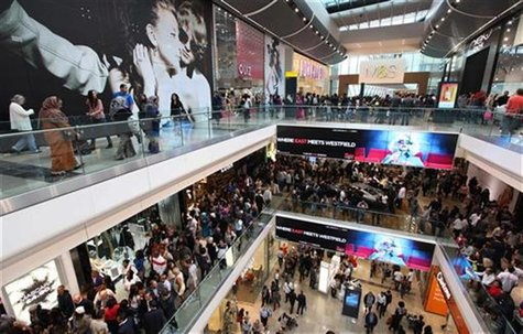 Shoppers crowd the walkways on opening day of the Westfield Stratford City shopping centre in east London September 13, 2011. REUTERS/Suzann