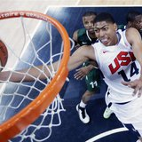 Anthony Davis (R) of the U.S. scores against Nigeria during their men's preliminary round Group A basketball match at the Basketball Arena d