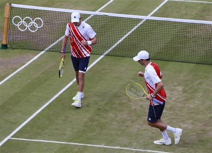 Brothers Mike Bryan (L) and Bob Bryan of the U.S. celebrate during their men's doubles tennis semi-final match against France's Julien Benne