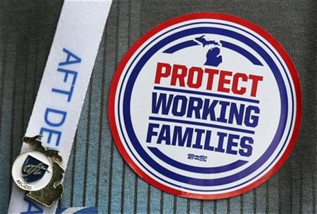 "An American Federation of Teachers union member attending the AFT convention in Detroit, Michigan, wears a ""Protect Working Families"" sticke"