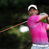 Tiger Woods of the U.S. watches his tee shot on the second hole during the third round of the WGC-Bridgestone Invitational golf tournament i