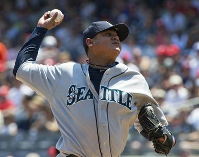 Seattle Mariners starting pitcher Felix Hernandez throws a pitch to the New York Yankees in the first inning of their MLB American League ga