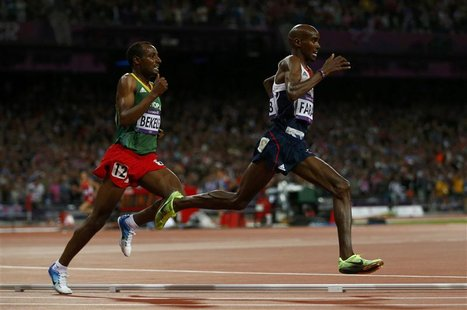 Britain's Mo Farah (R) runs through the final turn with Ethiopia's Tariku Bekele during the men's 10,000m final at the London 2012 Olympic G