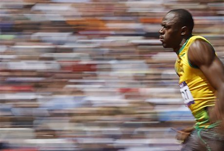 Usain Bolt of Jamaica runs on his way to winning his 100m heat round 1 during the London 2012 Olympic Games at the Olympic Stadium August 4,
