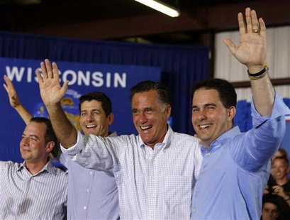 U.S. Republican Presidential candidate Mitt Romney (2nd R) waves next to Governor Scott Walker (R), Representative Paul Ryan (2nd L), and RN