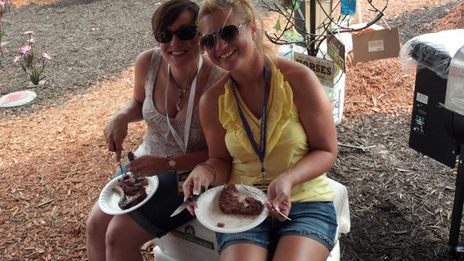 Nikki & Vanessa enjoying steak cooked by American Wood Fibers with their grill pellets.