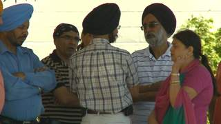 Local Sikhs stand outside their temple in Menasha, awaiting more information about the mass shooting that happened at a temple in Oak Creek on Sunday, August 5, 2012. (courtesy of FOX 11).