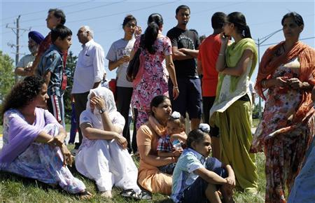 Members of the Sikh Temple wait for news following a mass shooting that left seven persons dead including the shooter in Oak Creek, Wisconsin August 5, 2012. REUTERS/Allen Fredrickson