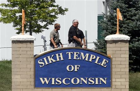 Officials gather near the Sikh Temple in Oak Creek in Wisconsin August 5, 2012 following a mass shooting inside and outside the Sikh Temple. Credit: REUTERS/Allen Fredrickson