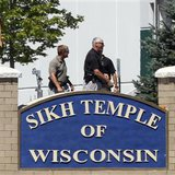 Officials gather near the Sikh Temple in Oak Creek, Wisconsin after a gunman killed six people on Sunday.