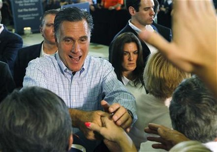 U.S. Republican presidential candidate Mitt Romney shakes hands with supporters after a campaign event in Golden, Colorado August 2, 2012. R
