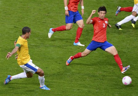 Brazil's Romulo (L) scores a goal past South Korea's Yun Suk-young during their men's semi-final soccer match at the London 2012 Olympic Gam