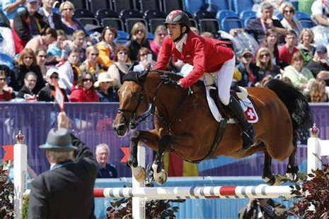 Switzerland's Steve Guerdat rides Nino des Buissonnets during the equestrian individual jumping second qualifier in Greenwich Park at the Lo