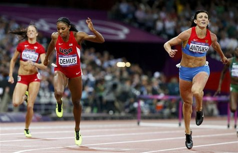 Russia's Natalya Antyukh (R) runs to win gold next to second placed Lashinda Demus of the U.S. in the women's 400m hurdles final during the