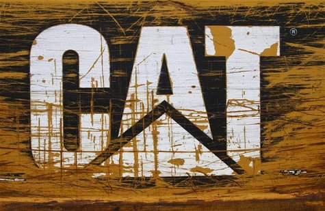 A scratched and worn Caterpillar logo is pictured at the back of a bulldozer in the rental equipment yard of Holt Caterpillar, the largest C
