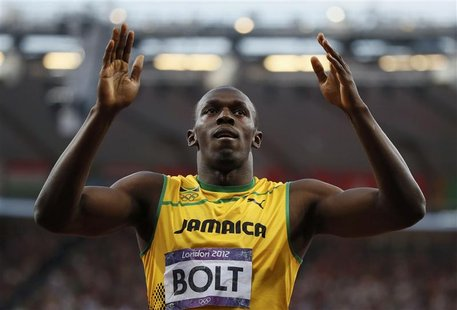 Jamaica's Usain Bolt celebrates after winning his men's 200m semi-final during the London 2012 Olympic Games at the Olympic Stadium August 8