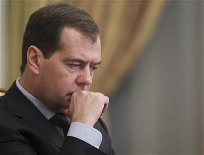 Russia's Prime Minister Dmitry Medvedev looks on during a government session at the Russian White House, headquarters of the federal governm