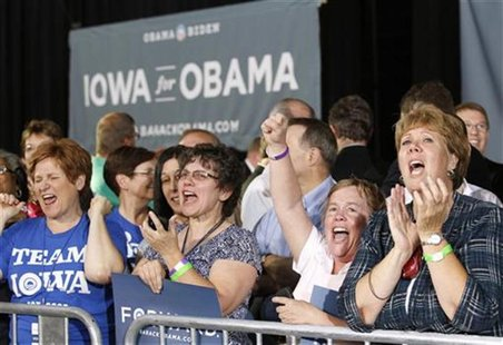 Women cheer as U.S. President Barack Obama speaks during a campaign rally at the Iowa State Fairgrounds in Des Moines, Iowa May 24, 2012. RE