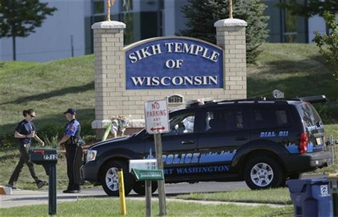 A law enforcement officer walks past the entrance to the Sikh Temple in Oak Creek, Wisconsin, August 7, 2012. REUTERS/John Gress