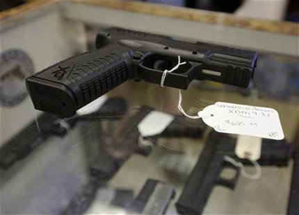 A hand gun, very similar to the gun used by alleged gunman Wade Michael Page, is seen at The Shooter Shop, where Page purchased the weapon,